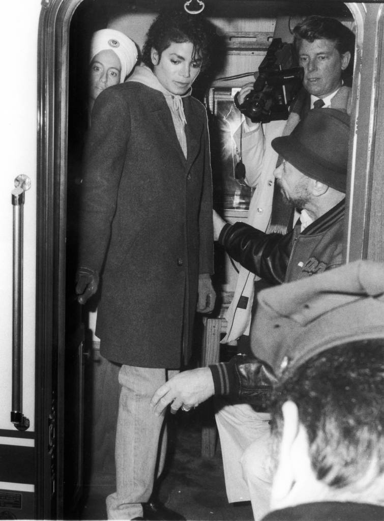 Popular American musician Michael Jackson (1958 - 2009) stands inside the door of subway train and speaks with crew members during the filming of the long-form music video for his song 'Bad,' directed by Martin Scorcese, New York, New York, 1987. (Photo by Vinnie Zuffante/Hulton Archive/Getty Images)
