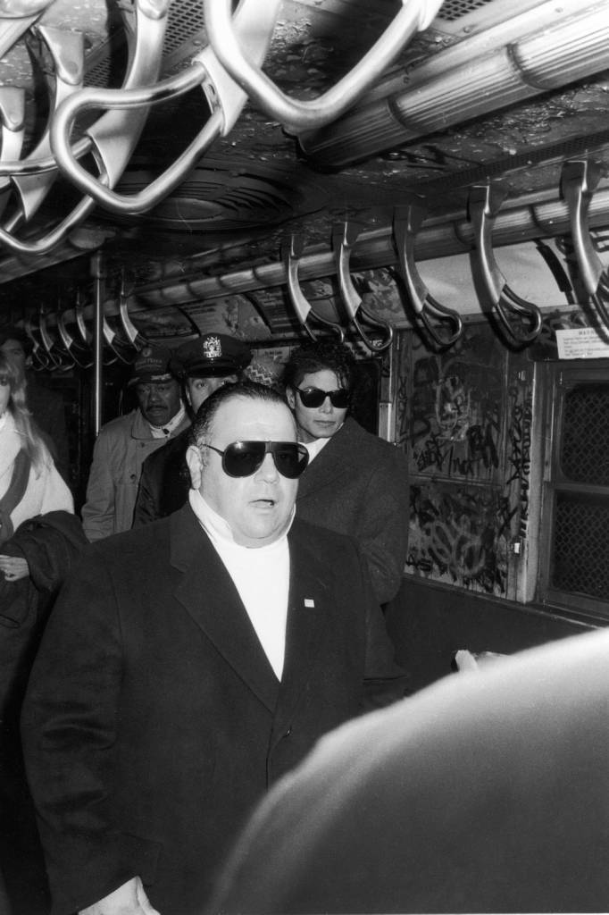 American producer and manager Frank DiLeo (fore, in sunglasses) and popular musician Michael Jackson (1958 - 2009) (center rear, also in sunglasses) stand in a subway car during the filming of the long-form music video for his song 'Bad,' directed by Martin Scorcese, New York, New York, 1987. (Photo by Vinnie Zuffante/Hulton Archive/Getty Images)