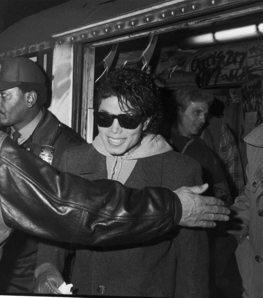 Popular American musician Michael Jackson (1958 ? 2009) smiles as he steps of the a subway car during the filming of the long-form music video for his song 'Bad,' directed by Martin Scorcese, New York, New York, 1987. (Photo by Vinnie Zuffante/Hulton Archive/Getty Images)