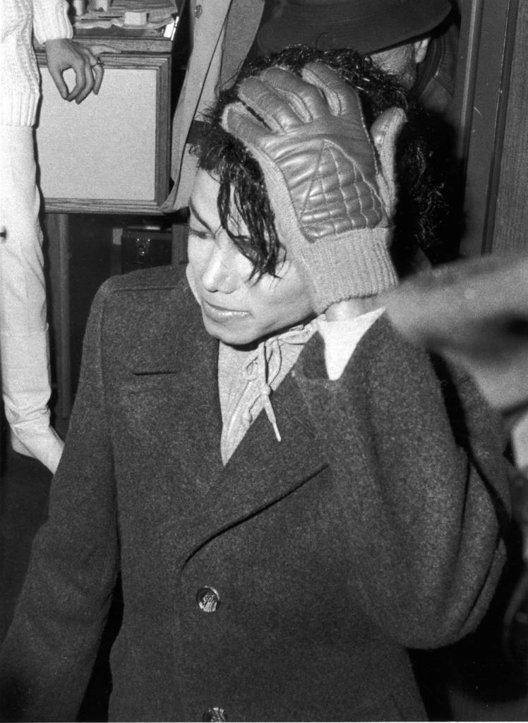 Popular American musician Michael Jackson (1958 - 2009) stands with a gloved hand on his head during the filming of the long-form music video for his song 'Bad,' directed by Martin Scorcese, New York, New York, 1987. (Photo by Vinnie Zuffante/Hulton Archive/Getty Images)