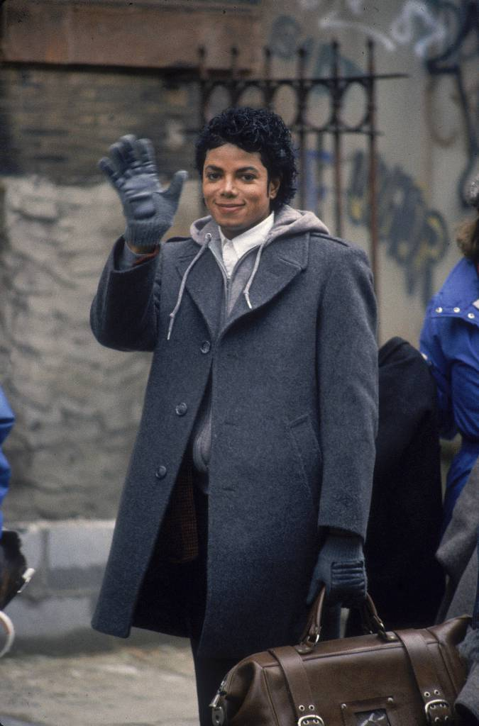 Popular American musician Michael Jackson (1958 - 2009) waves during the filming of the long-form music video for his song 'Bad,' directed by Martin Scorcese, New York, New York, 1987. (Photo by Vinnie Zuffante/Hulton Archive/Getty Images)