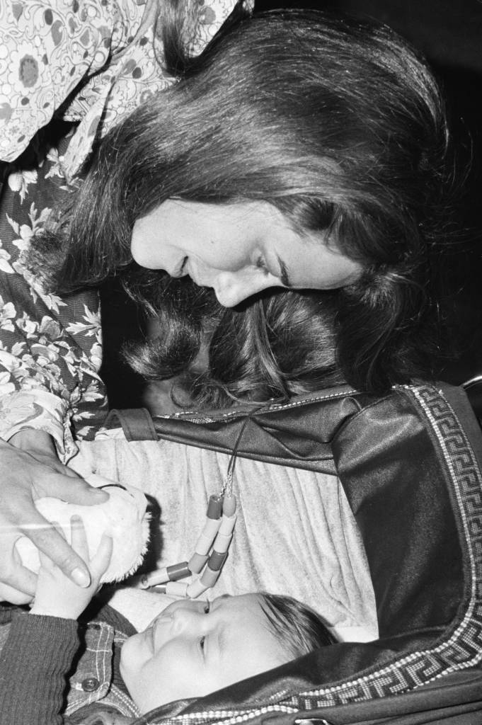 English actress Charlotte Rampling with her 8 month-old baby son Barnaby, at Heathrow Airport, London, 11th May 1973. Rampling, her son and her husband Bryan Southcombe are on their way to Dublin, where Rampling is to begin rehearsals for the film 'Zardoz', directed by John Boorman. (Photo by James Jackson/Evening Standard/Hulton Archive/Getty Images)