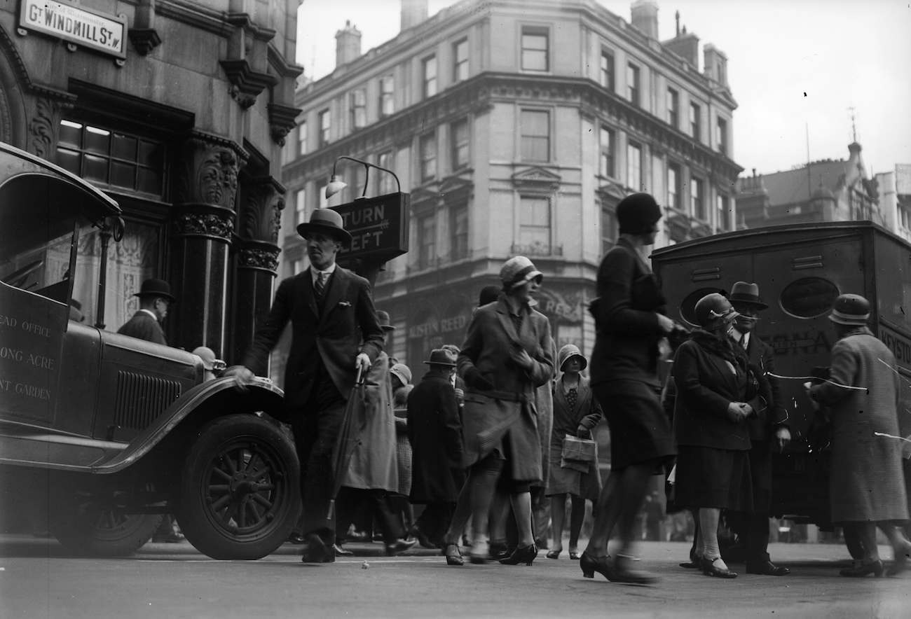 1930:  Pedestrians crossing Great Windmill Street, Soho, London.  (Photo by General Photographic Agency/Getty Images)