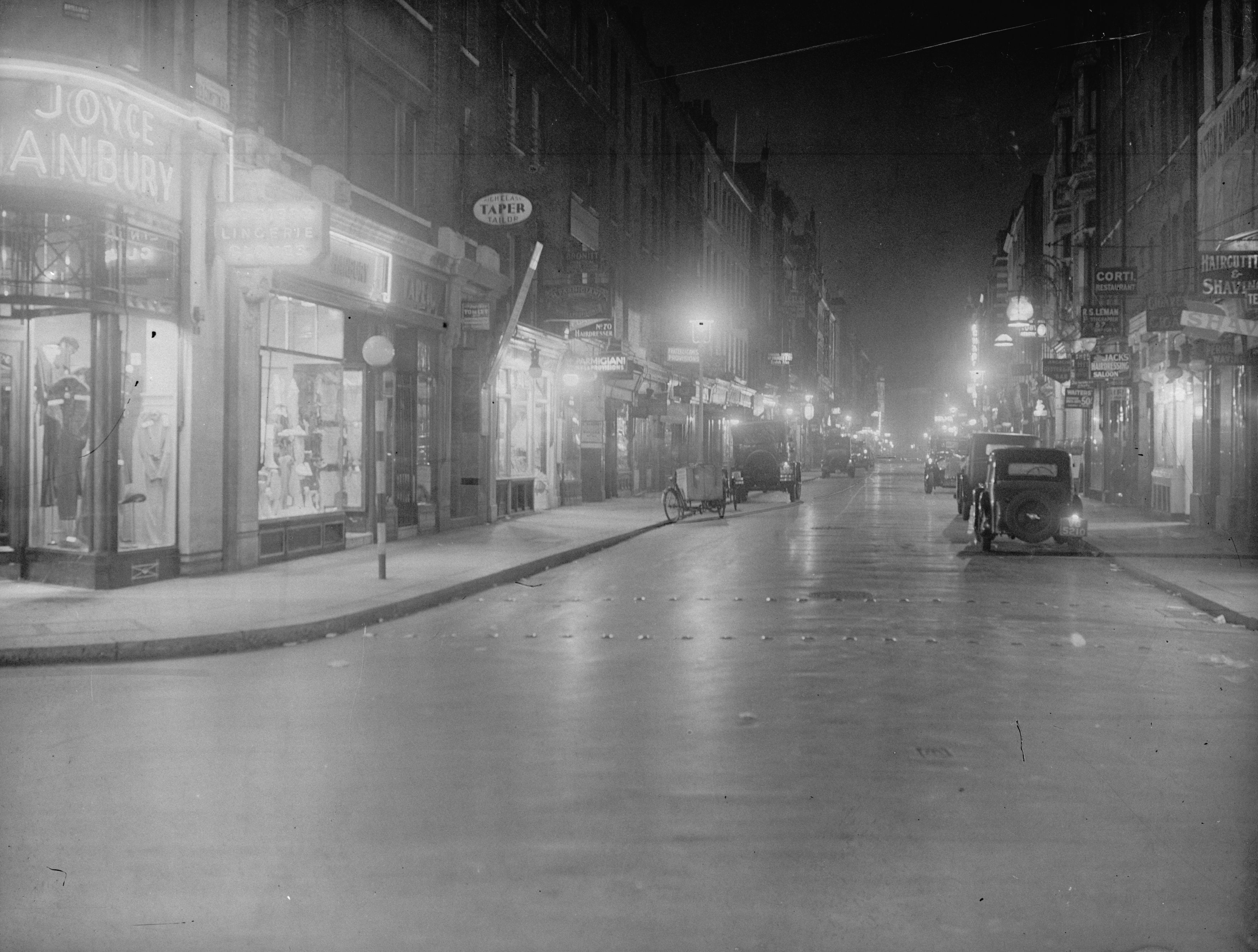 1936:  Old Compton Street at night time.  (Photo by General Photographic Agency/Getty Images)