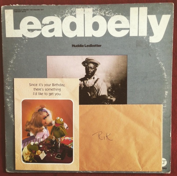 "Andy Levine found this Leadbelly record at@jerrysrecords in Pittsburgh, PA. Inside he found a Muppets greeting card addressed to ""Rik"" from ""Donna"" featuring Miss Piggy telling Kermit ""Since it's your birthday, there's something I'd like to get you."" When you open the card it says simply, ""Alone."""
