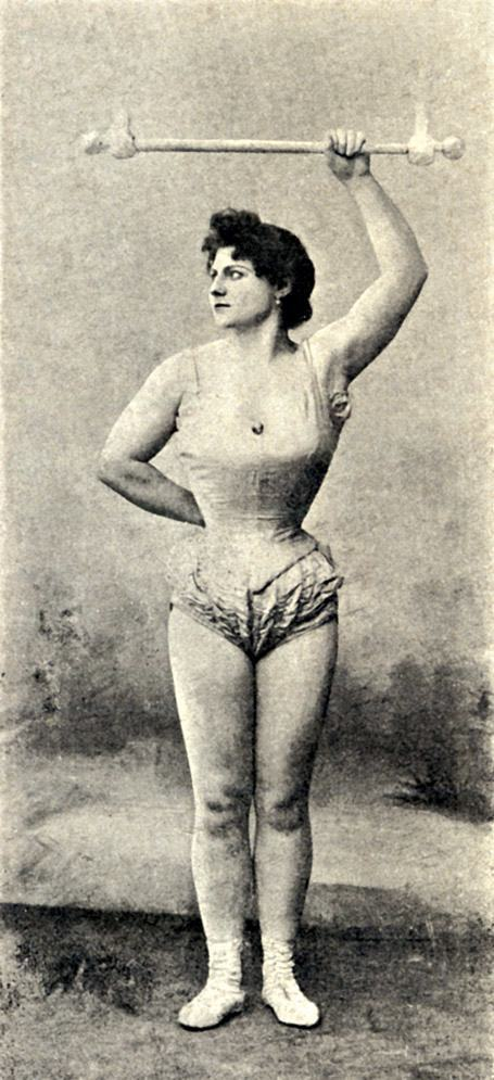A way to diffuse male worries about women being too strong and threatening was to portray them in photos that emphasized their grace and beauty rather than their mass and musculature. Trapeze artists like this one had highly developed arms and upper bodies; it is significant that the photographer chose not to emphasize those parts of the subject's anatomy. Although her name and date are unknown, this gymnast is almost certainly a circus or music hall performer from the 1890s.