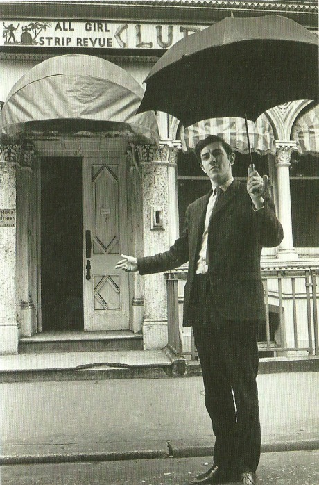 """Peter Cook by the building at 18 Greek Street, Soho, venues of The Establishment Club (1961-1964). """"My dread in my last year in Cambridge was that somebody else would have this very obvious idea to do political cabaret uncensored by the Lord Chamberlain. I thought it was a certainty."""" Via"""