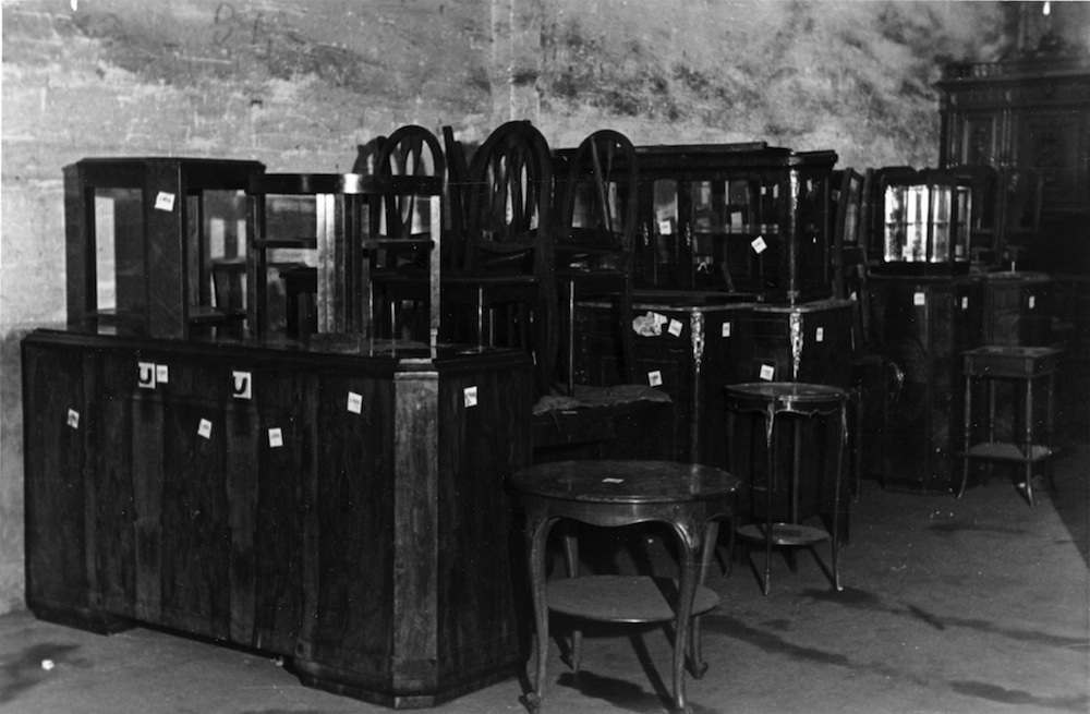 "The former internees Gensburger interviewed called this the ""kitchen dresser department""; the location of the photograph remains unidentified."