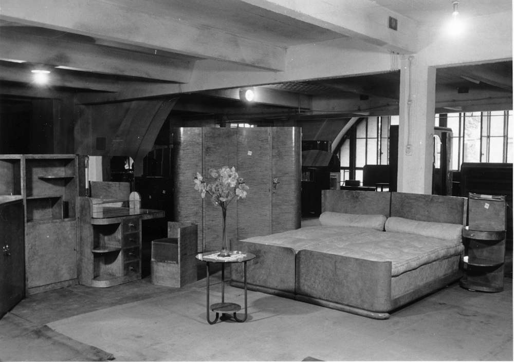 A room of looted furniture at Lévitan, set up in department-store display mode.