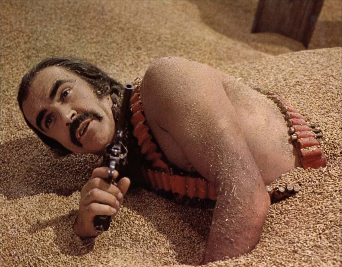 Zed (Sean Connery) escapes from the land of The Exterminators (Brutals) by hiding in the godhead Zardoz.