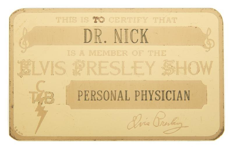 "An identification card given to Dr. George Nichopoulos (Dr. Nick) by Elvis Presley. The gold tone card is engraved ""This is to Certify that/ Dr. Nick/ Is a Member of the/ Elvis Presley Show/ TCB/ Personal Physician"" and contains an Elvis Presley facsimile signature. An Apollo Trophies sticker is affixed on the back of the card."