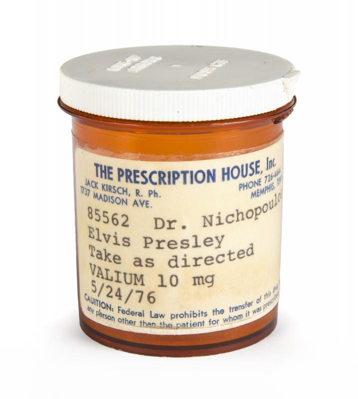 An Elvis Presley prescription pill bottle for Valium. The bottle bears a Prescription House label for 10 mg Valium prescribed to Elvis Presley, dated May 24, 1976, and prescribed by Dr. Nichopoulos (Dr. Nick). The label instructs that Presley should take as directed.
