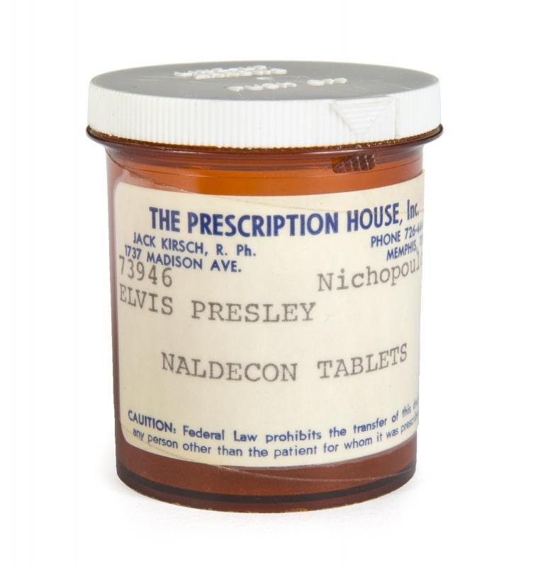 An Elvis Presley Naldecon prescription bottle, undated, with a label from The Prescription House, prescribed by Dr. George Nichopoulos (Dr. Nick). Naldecon is an antihistamine. Accompanied by a letter of authenticity from George Klein.