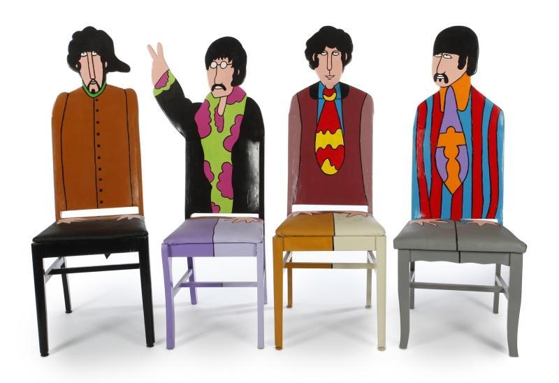 "A set of four graduated handmade figural chairs made by Todd Fendos depicting John, Paul, Ringo and George from Yellow Submarine . Each signed ""Fendos"" on the right side rail. A gift to Ringo Starr from his brother-in-law, musician Joe Walsh. ""This is a set of very attractive chairs that Joe Walsh in his goodness thought I should have. Peace and love. thank you Joe."" – Ringo"