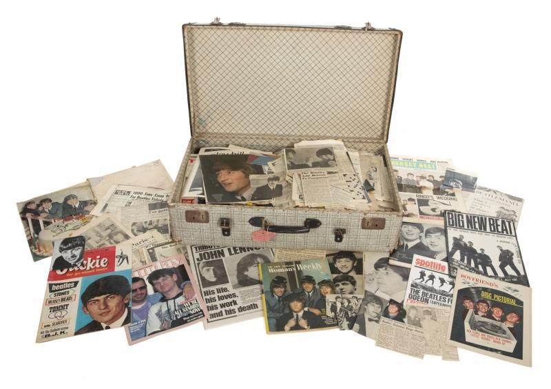 "A large trunk filled with a quantity of vintage newspapers, magazines and clippings from a wide variety of news outlets including envelopes labeled, ""Cuttings from paper's Paris"" and ""Palladium Cuttings Oct 13th 1963."" The trunk also contains two ""Reveille Special"" color posters of the Beatles posing on a beach. The press archive was compiled and gathered in this trunk by Starr's mother Elsie Starkey as she witnessed the global spread of Beatlemania."