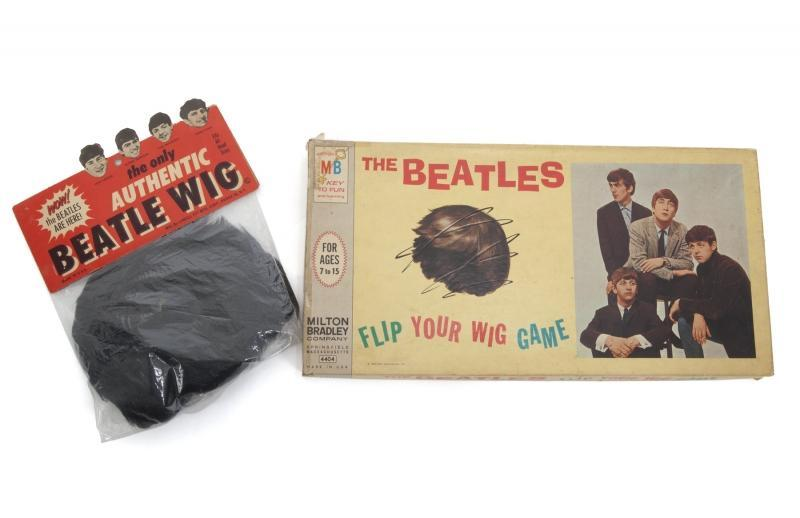 "A 1964 Milton Bradley Beatles ""Flip Your Wig"" board game. Together with an ""authentic"" Beatle wig in original packaging, by Lowell Toy Mfg. Corp."