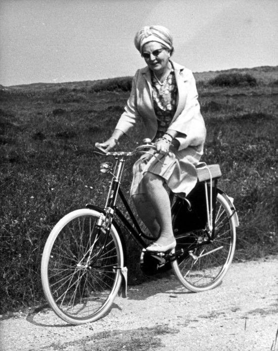 The Dutch queen Juliana riding a bike during a visit to the island Terschelling. The Netherlands, July 11, 1967.