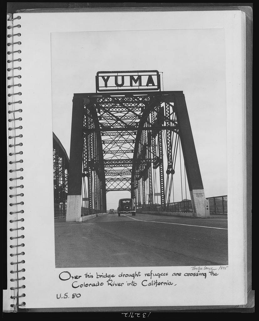 Over this bridge drought refugees are crossing the Colorado River into California. U.S. 80 / Dorothea Lange, 1935.