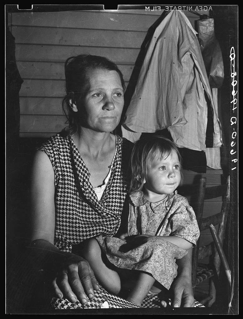 Tulare County. Farm Security Administration camp (FSA) for migratory agricultural workers at Farmersville. Mother and child, come to California from Oklahoma. They have six children, aged two to nineteen years. The mother finished the eighth grade in school. They left their farming in Chicasha in the fall of 1936 to go to Arizona to pick cotton. They returned to Oklahoma to try again; failed and re-entered California February 27, 1938 to pick peas under a labor contractor. The father is chairman of camp council