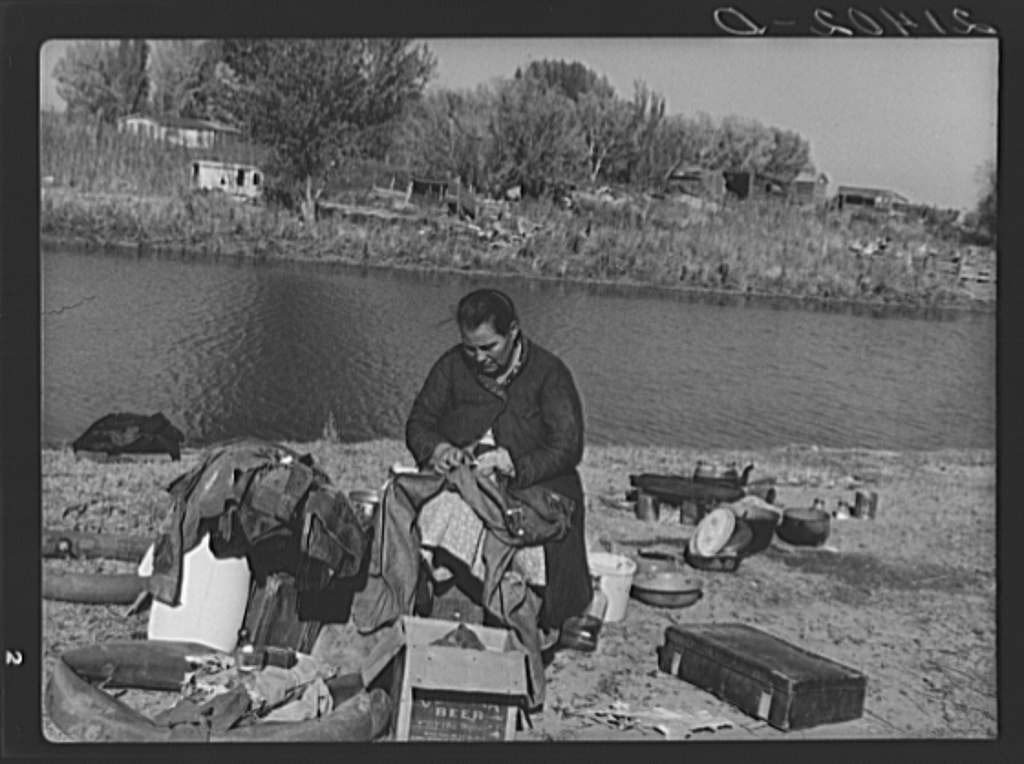 Mother of migrant family sewing. Near Vale, Malheur County, Oregon Creator(s): Lange, Dorothea, photographer