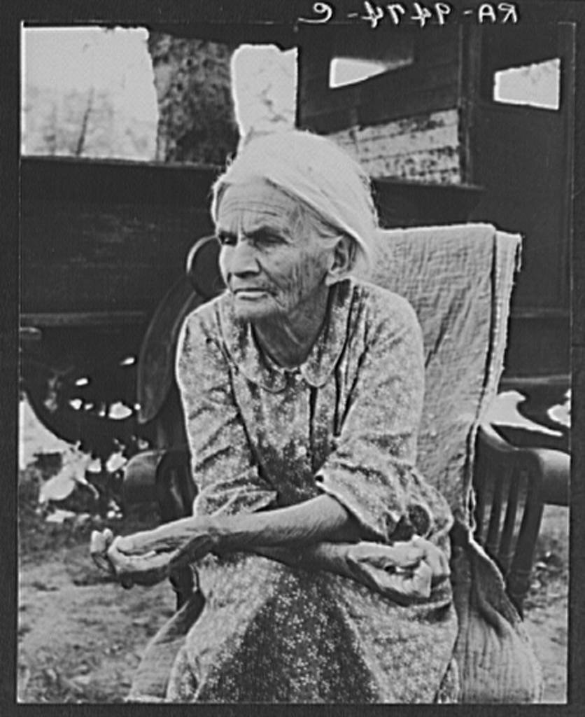 "Mother of family camped near a creek bed, panning for gold. ""Slept in a bed all my life long till now--sleeping on the ground."" Near Redding, California"