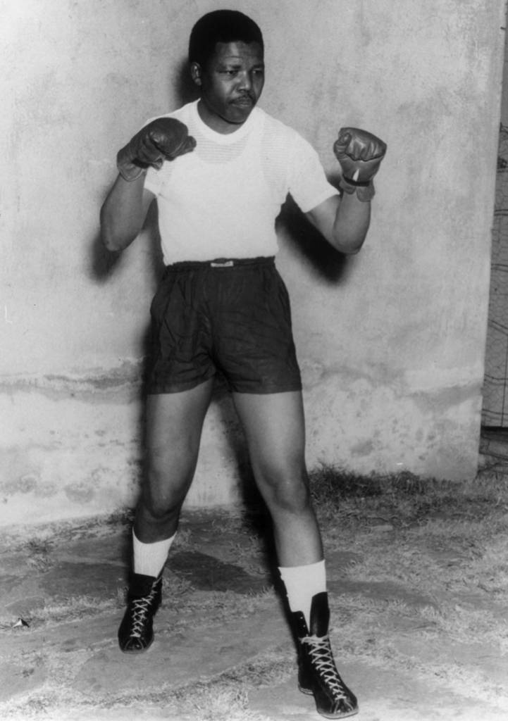 Nelson Mandela, leader of the African National Congress (ANC), adopts a boxing pose, wearing shorts, t-shirt and boxing gloves, circa 1950. (Photo by Keystone/Hulton Archive/Getty Images)
