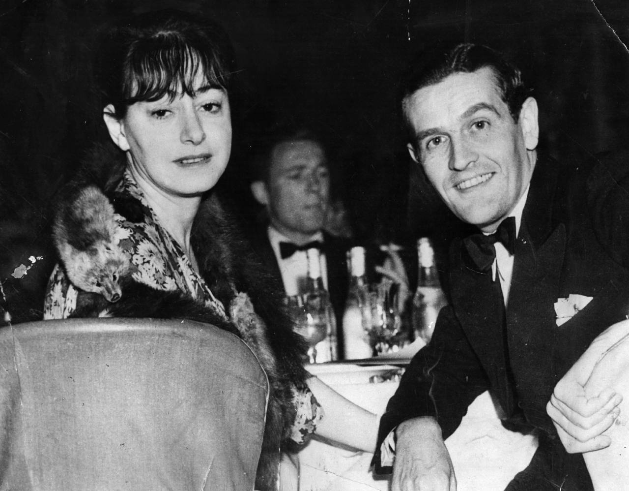 American journalist, writer and wit Dorothy Parker (1893 - 1967), at a restaurant. with her husband, Alan Campbell. Original Publication: People Disc - HK0426 (Photo by Evening Standard/Getty Images)