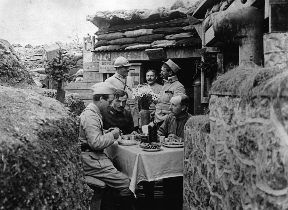 French officers dining in style in a trench near the front line. (Photo by Hulton Archive/Getty Images)
