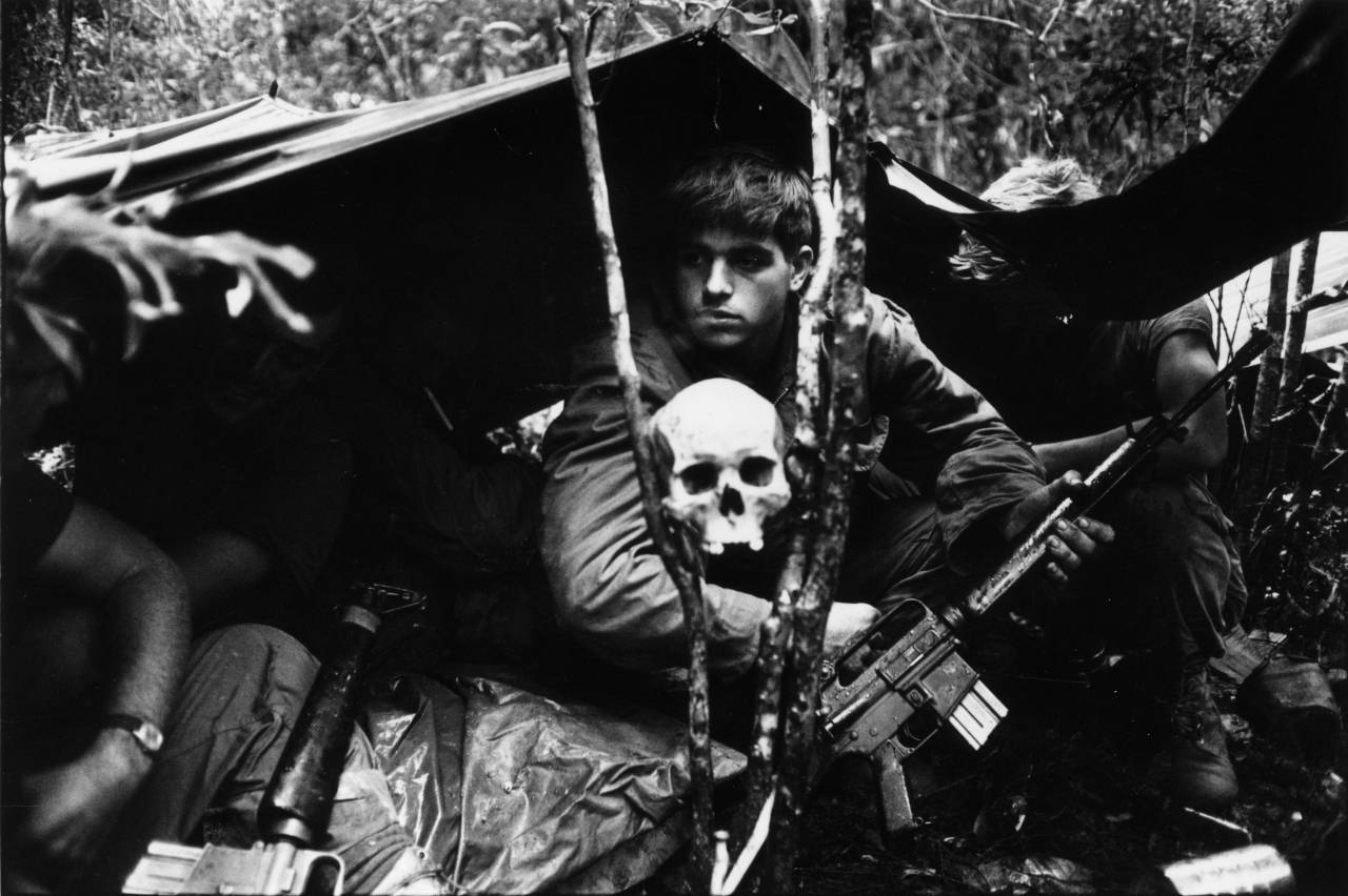 A human skull keeps watch over US soldiers encamped in the Vietnamese jungle during the Vietnam War. (Photo by Terry Fincher/Getty Images)