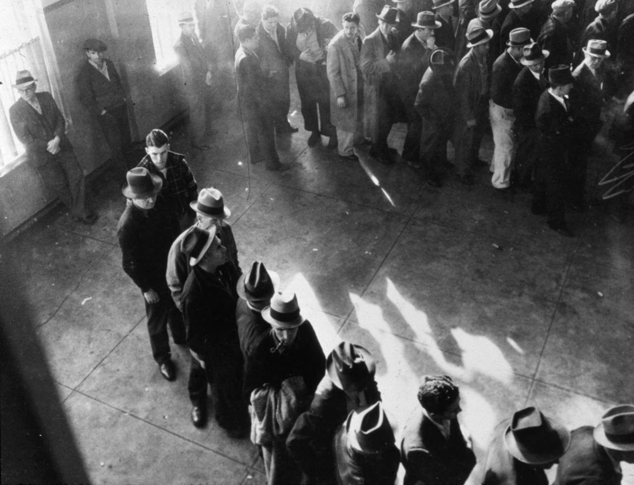 A line of men inside the state employment service office in San Francisco, California. 1938