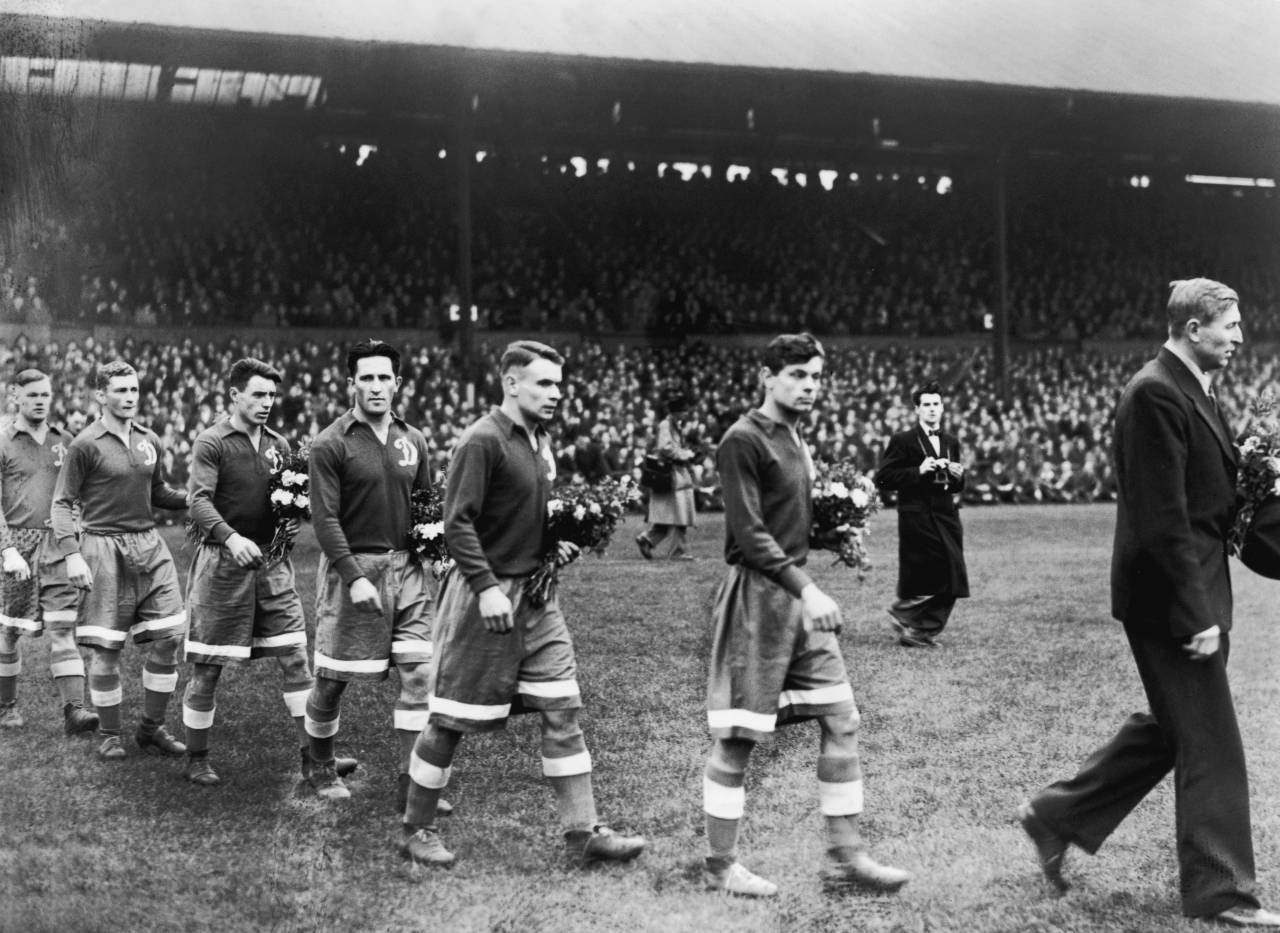 The Moscow Dynamo team walk on to the pitch at Stamford Bridge with bouquets of flowers to present to the Chelsea team before the match. The game ended in a 3-3 draw. (Photo by J A Hampton/Getty Images)