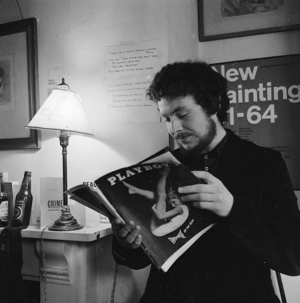 Richard Exton, a left-wing, former grammar school boy reading English at St Edmund Hall, Oxford, skims through an edition of 'Playboy' magazine. (Photo by Chris Ware/Getty Images)
