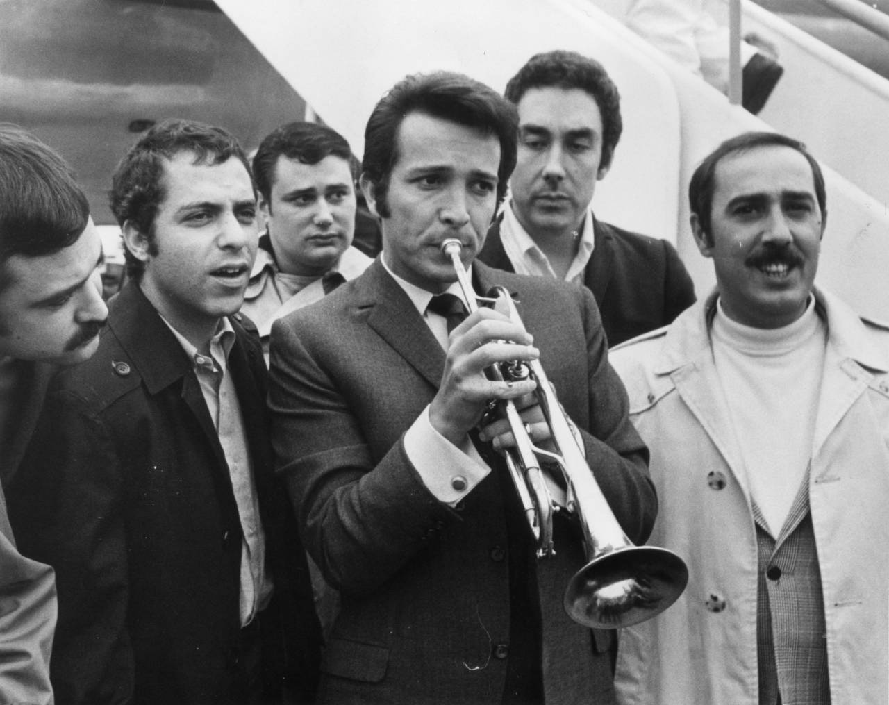 6th October 1966: Trumpeter Herb Alpert with members of his combo on their arrival at London Airport. They are here for a concert at the Albert Hall. (Photo by Central Press/Getty Images)
