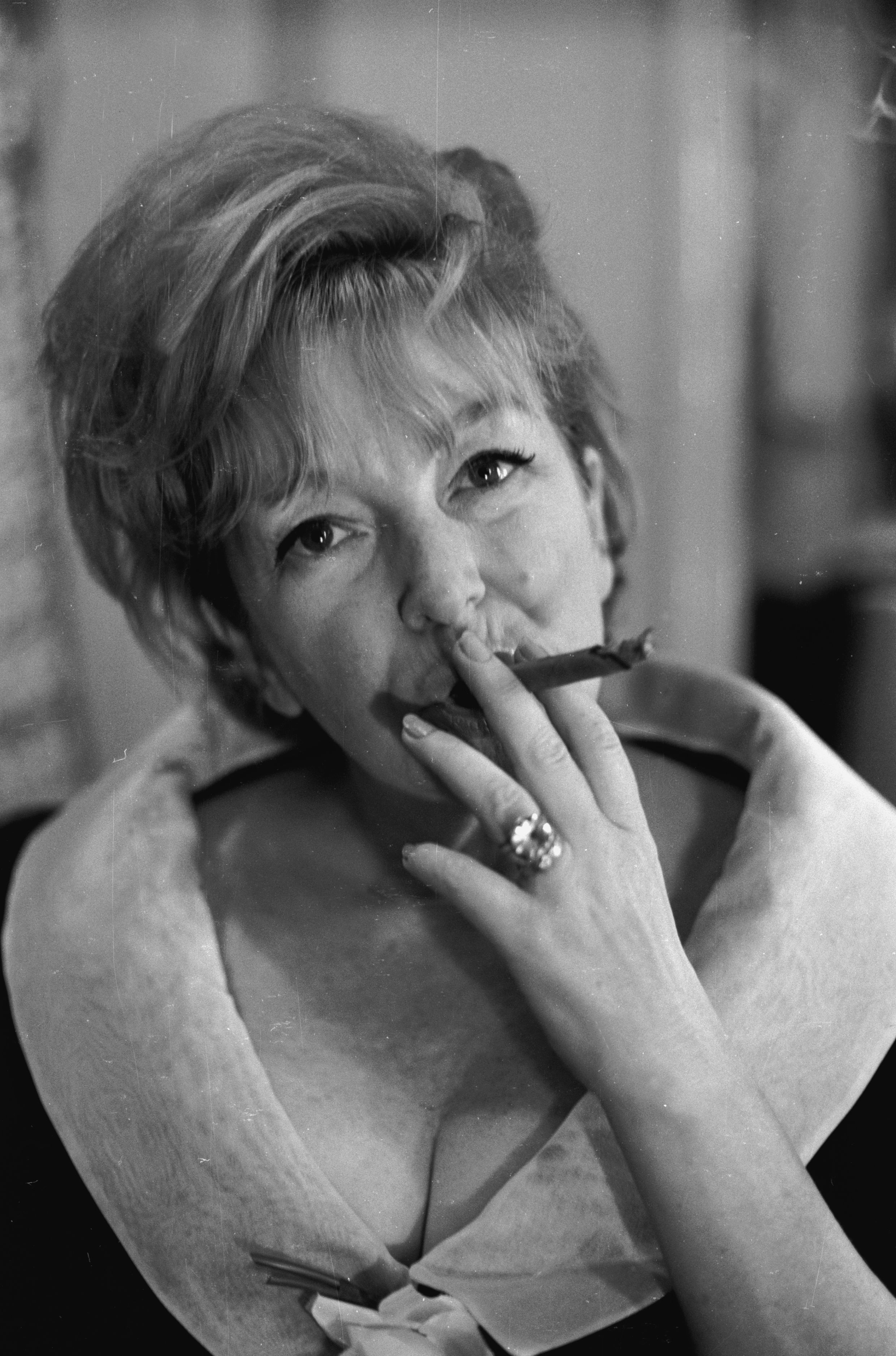 19th June 1965: Actress Beryl Reid learning to smoke a cigar for her role in 'The Killing of Sister George'. (Photo by Victor Blackman/Express/Getty Images)