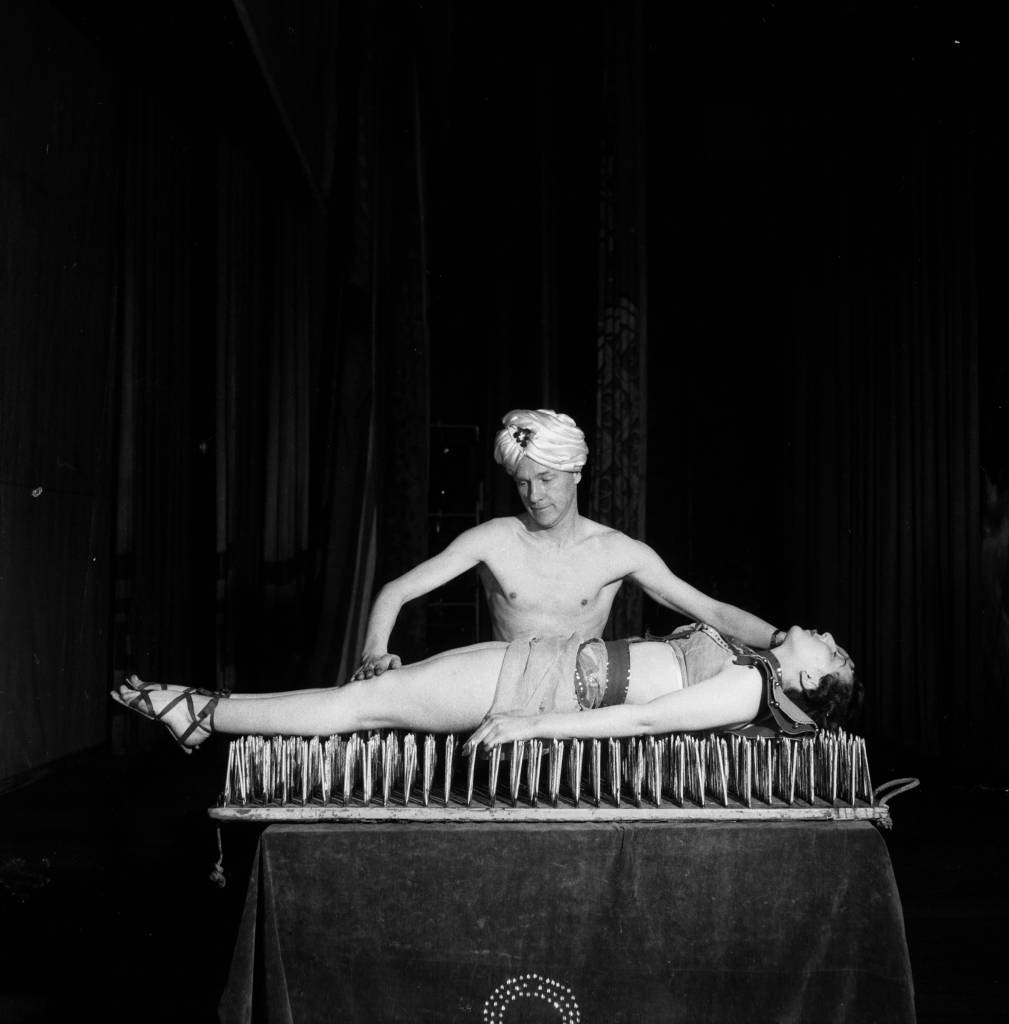 1955: A fakir performing the bed of nails trick. (Photo by Peter Purdy/BIPs/Getty Images)