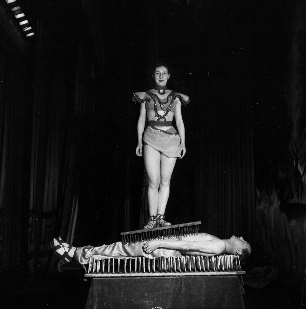 1955: A fakir performs the bed of nails trick. (Photo by Peter Purdy/BIPs/Getty Images)