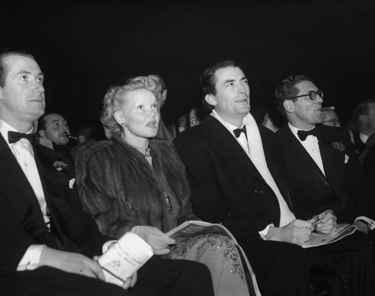 25th January 1950: American actor Gregory Peck (1916 - 2003) and his first wife Greta attend a boxing match between Freddie Mills and Joey Maxim at Earl's Court, London. (Photo by Ron Gerelli/Express/Getty Images)