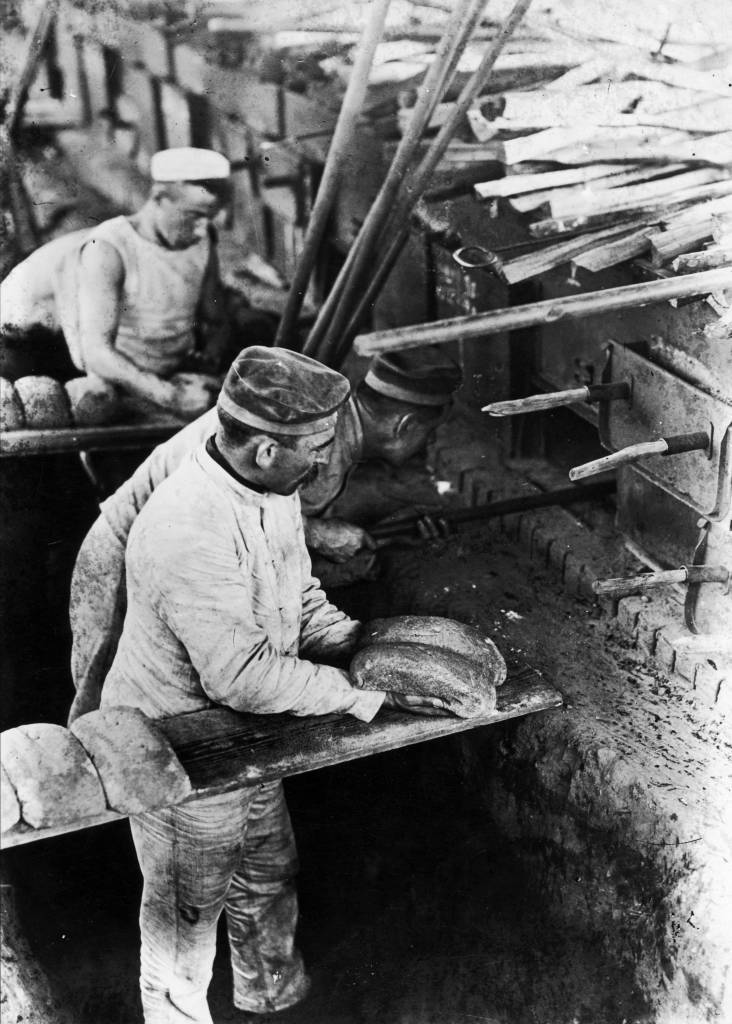 circa 1916: German soldiers making bread in ovens on the field. (Photo by Topical Press Agency/Getty Images)