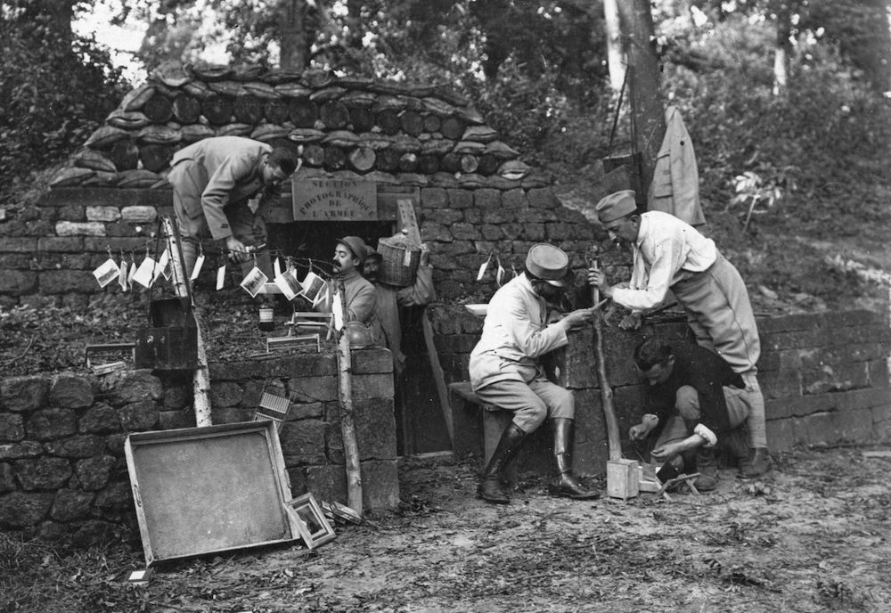 5th October 1917: The French photographic section in a dug out in the trenches in the l'Oise. Some photos are hung out to dry. (Photo by Henry Guttmann/Getty Images)