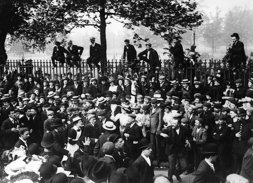 1st June 1903: A huge crowd lining Park Lane in central London watch waitress Annie Granger on her way to winning the Waitresses Walking Race from the City to the West End on Whit Monday. The race between the British Tea Table Co and Pearce and Plenty, covered a route of four miles and was won in 47 minutes. London Stereoscopic & Photographic Company. (Photo by London Stereoscopic Company/Getty Images)