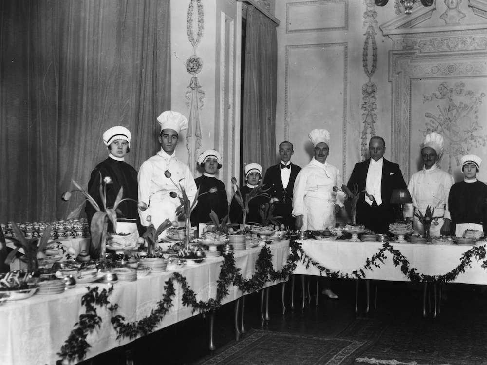 23rd February 1927: The staff at Dartmouth House with the buffet before a ball to celebrate the English Speaking Union. (Photo by G. Adams/Topical Press Agency/Getty Images)