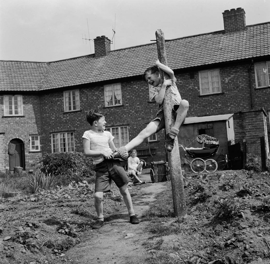 June 1958: 12 year old John Ryder and his friend Trevor Briscoe play in a back garden in the coal mining area of Amthorpe, near Doncaster. Surprisingly, miner's son John wants to be a ballet dancer and shows guts as well as ballet talent, fighting any local boys who call him 'sissy'. He has also joined the school boxing team to prove it. (Photo by John Pratt/Keystone Features/Getty Images)