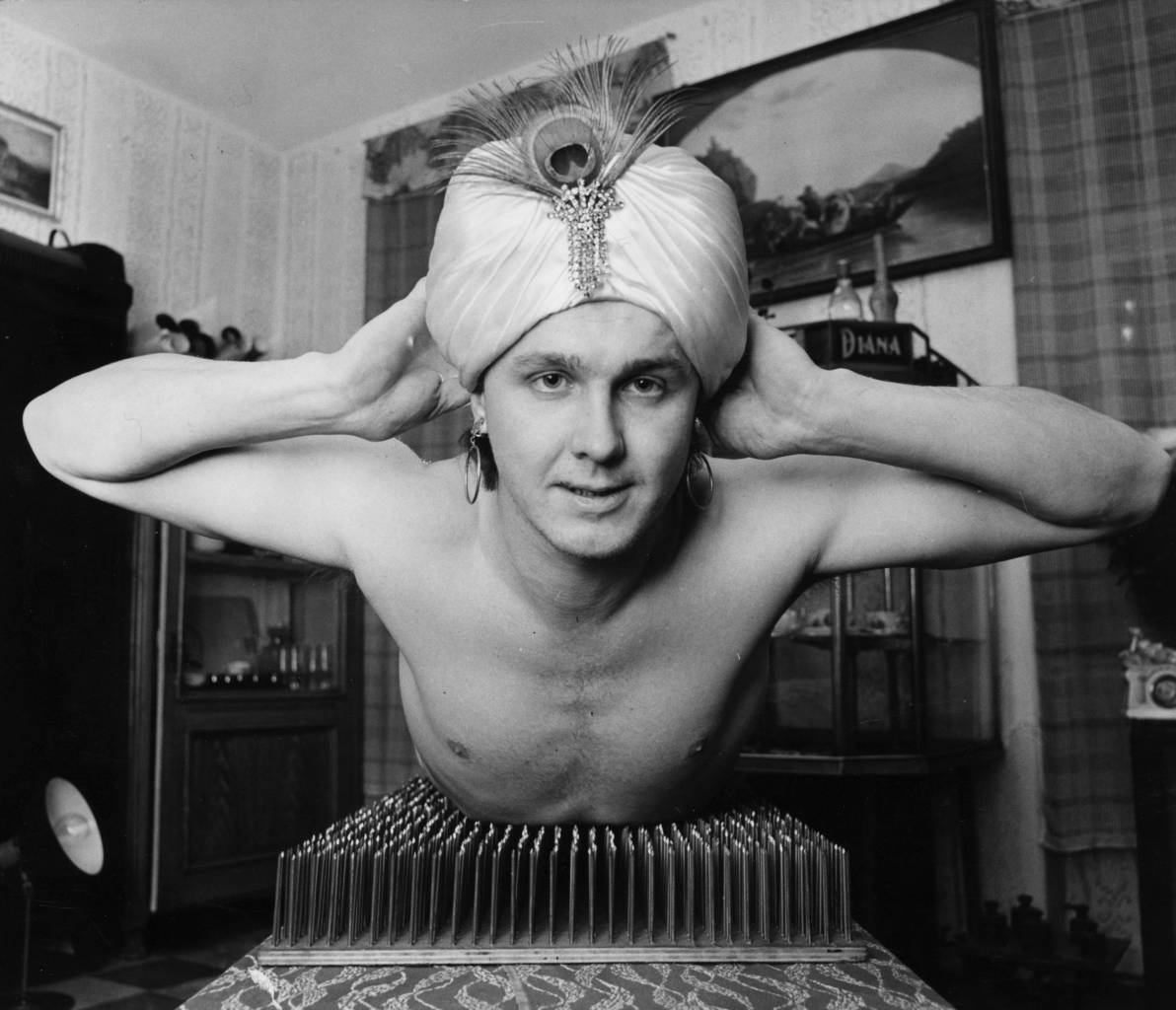 February 1981: Czech stuntman Z Zahradka performs his bed of nails act. (Photo by Keystone Features/Getty Images)