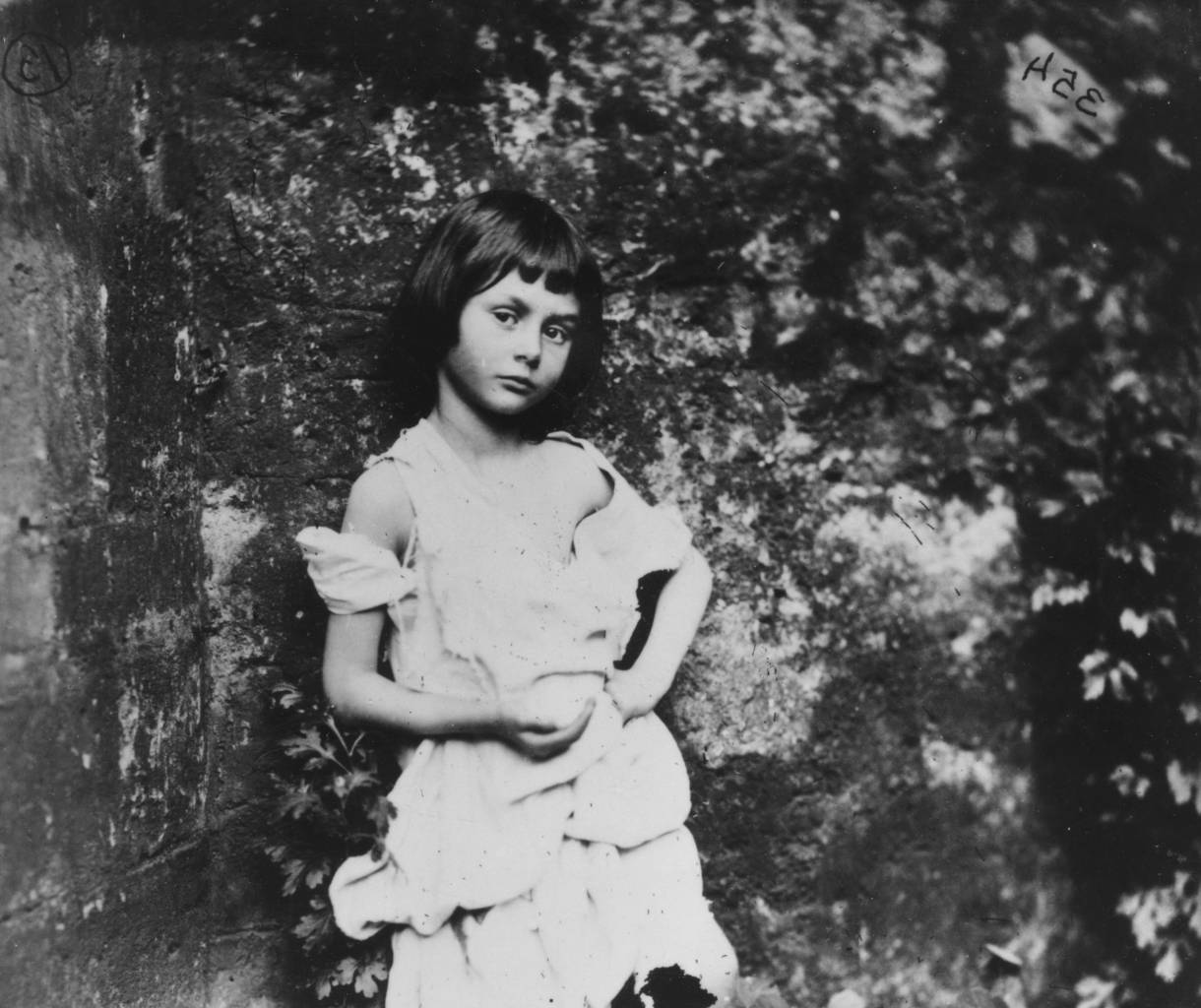 1858: Alice Liddell (1852 - 1934), the inspiration for Lewis Carroll's fictional character Alice in 'Alice in Wonderland'. She is posing as 'The Beggar-Maid.' (Photo by Lewis Carroll/Getty Images)