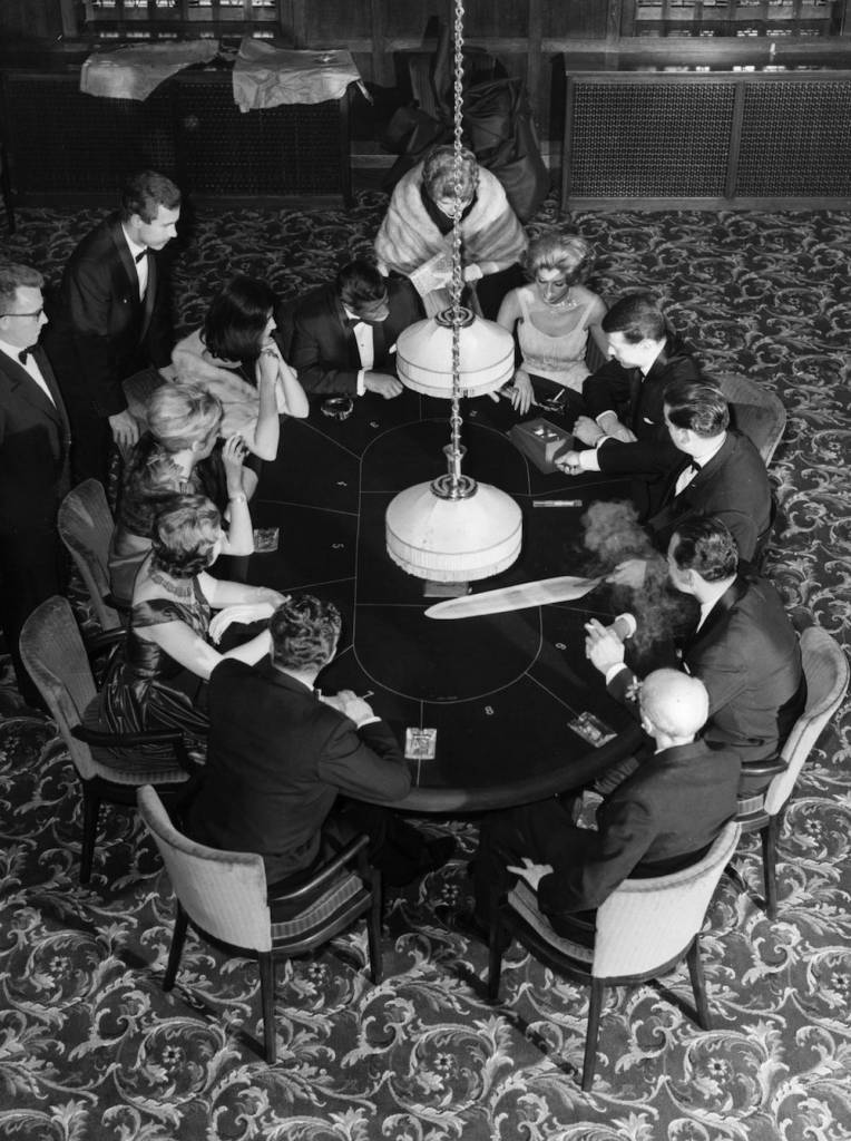 10th October 1962: Playing Chemin de fer (Chemmy) a form of baccarat in a gaming room at the Playboy Club, an exclusive residential country club in Barnet, north London. No connection to the Playboy Club of America ! (Photo by Kent Gavin/Keystone/Getty Images)