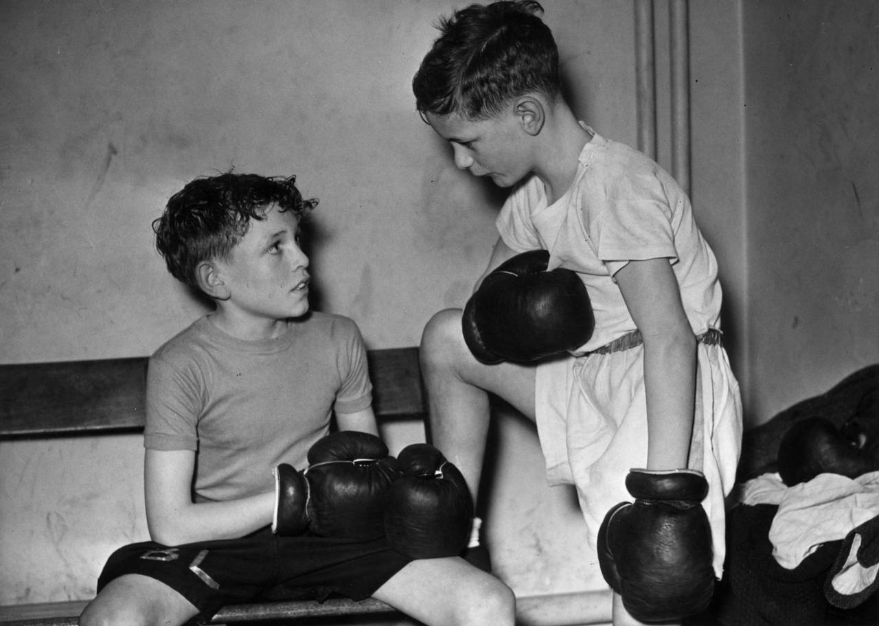 14th February 1953: Two young boxers. (Photo by Harry Todd/Fox Photos/Getty Images)