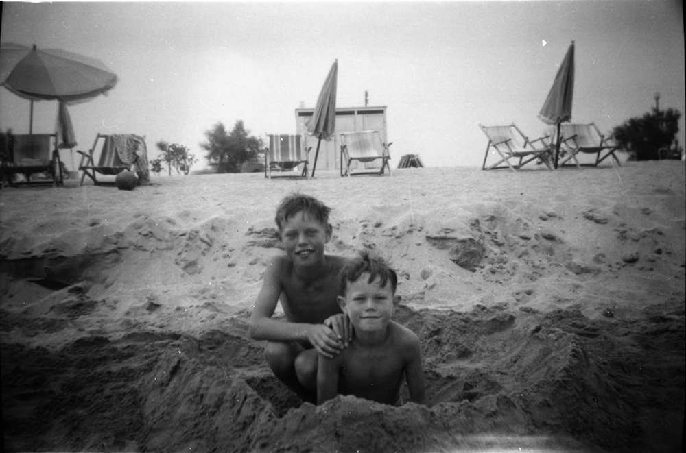 UNSPECIFIED LOCATION - CIRCA 1951: (EMBARGOED FOR PRINT USAGE UNTIL THURSDAY JULY 2ND 2015) Mick Jagger (left) aged 8, on a family holiday with his younger brother Chris (right) in 1951. This previously unseen image will form part of The Rolling Stones - 'Exhibitionism' at Londons Saatchi Gallery. Mick Jagger, Keith Richards, Charlie Watts and Ronnie Wood have opened their personal archives and found never before seen photographs of themselves as youngsters. These along with hundreds more rare and unseen images will create the first ever international Rolling Stones exhibition which will open at the Saatchi Gallery in April 2016. (Photo by Stones Archive/Getty Images)