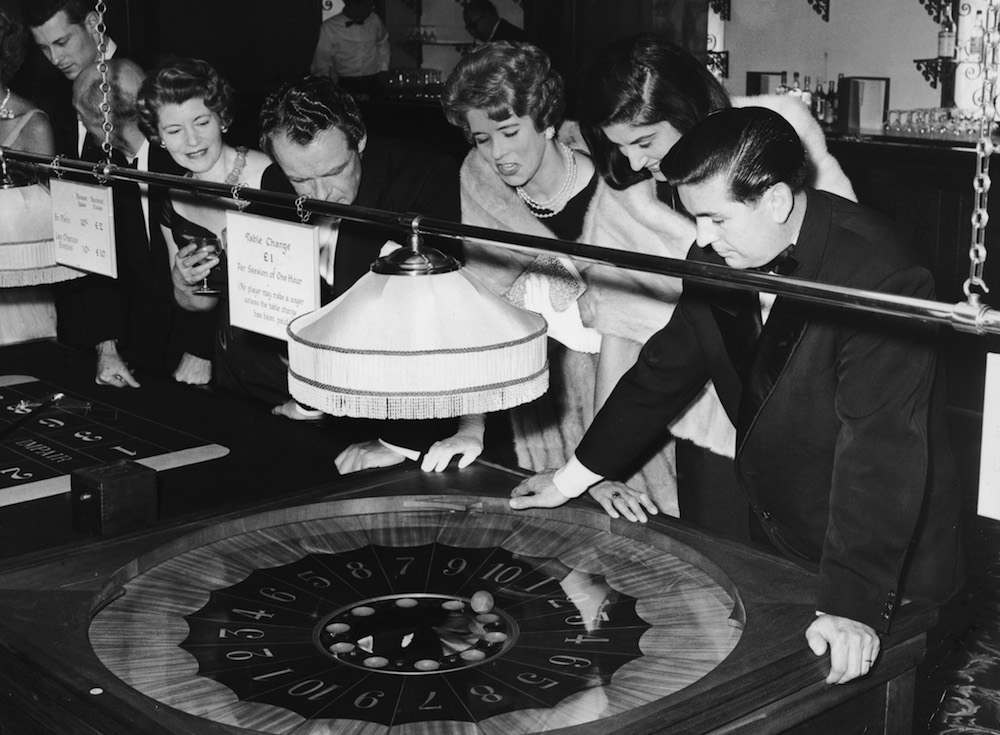 Guests enjoy a game of La Boule at the newly-opened Playboy Club in Barnet, 10th October 1962. (Photo by Kent Gavin/Keystone/Hulton Archive/Getty Images)