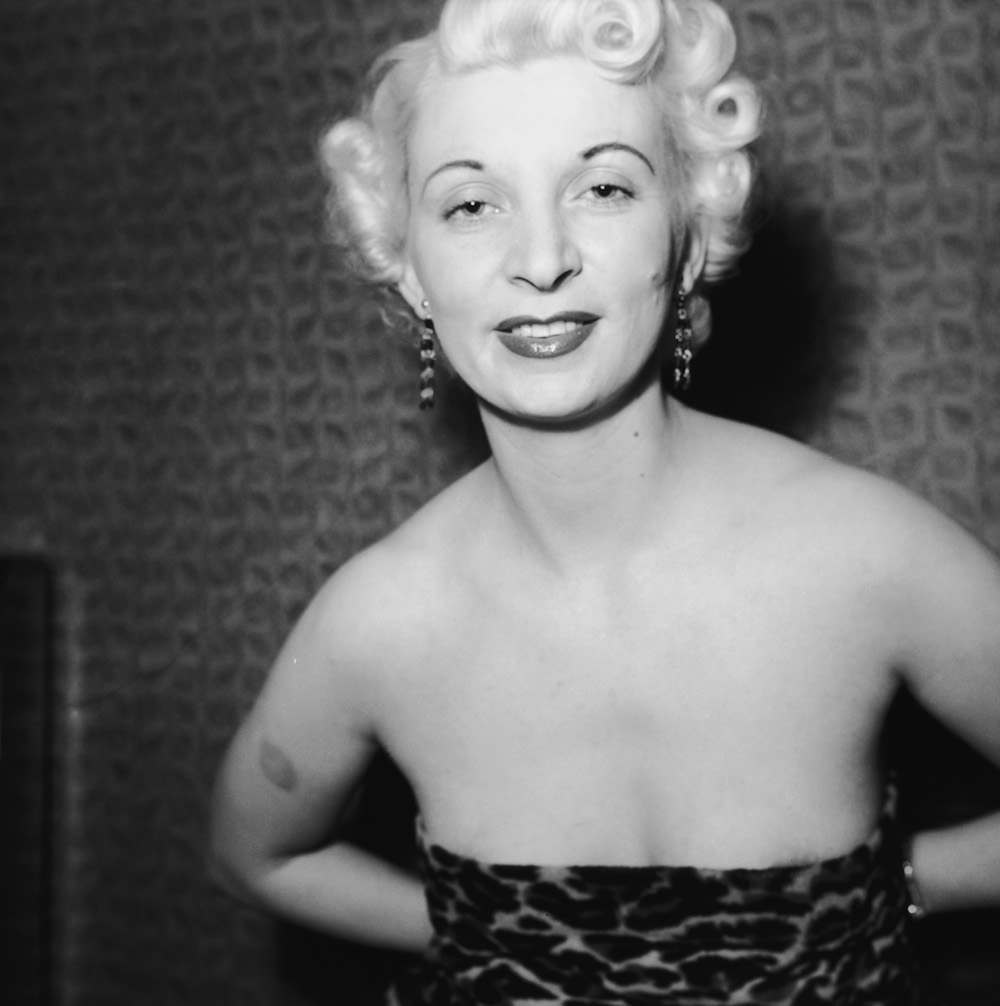 Night club manageress Ruth Ellis (1926 - 1955) poses in leopard skin for one Captain Ritchie, 1954. The setting is probably the flat above her club on the Brompton Road in Knightsbridge, London. In 1955, Ellis was convicted of the murder of her lover, David Blakely, and hanged at Holloway Prison, becoming the last woman to receive the death penalty in Britain. (Photo by Hulton Archive/Getty Images)