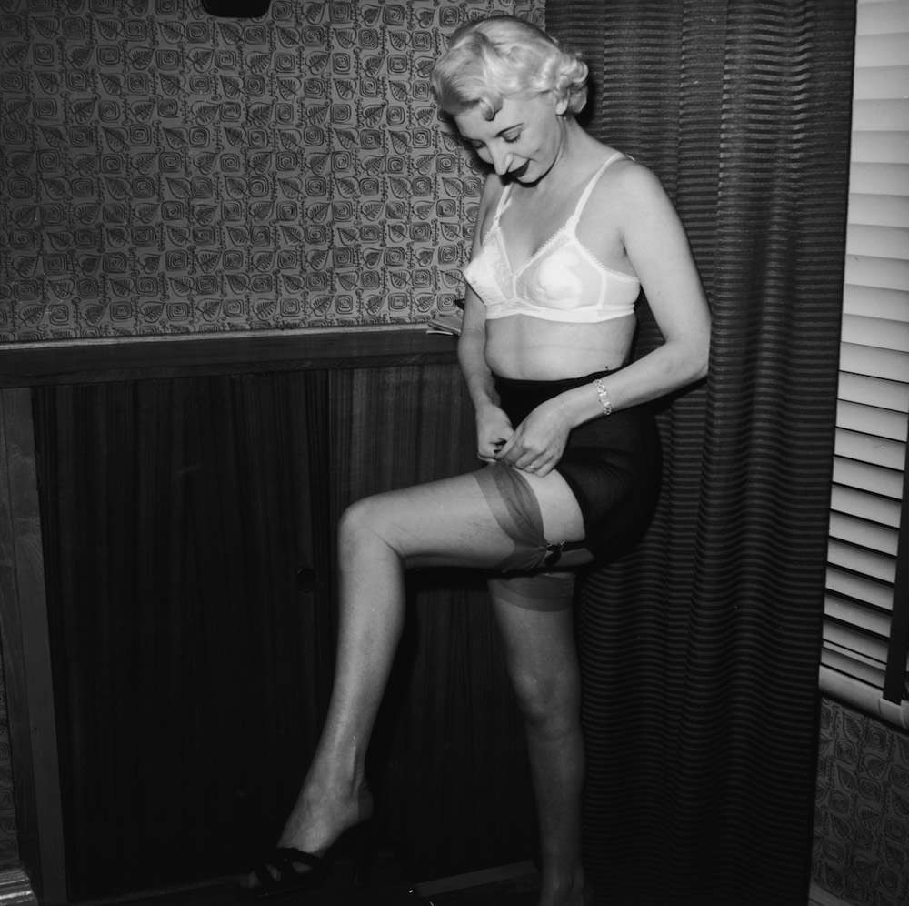 Night club manageress Ruth Ellis (1926 - 1955) poses in her underwear for one Captain Ritchie, 1954. The setting is probably the flat above her club on the Brompton Road in Knightsbridge, London. In 1955, Ellis was convicted of the murder of her lover, David Blakely, and hanged at Holloway Prison, becoming the last woman to receive the death penalty in Britain. (Photo by Hulton Archive/Getty Images)